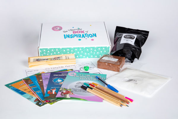 Enchanted Forest Inspiration Box unpacked, with clay, paper, pencils, activities, games and more
