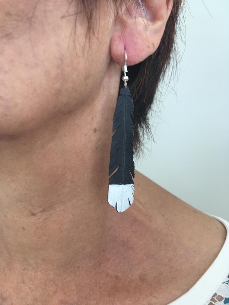 Traditional Huia feather earrings handmade from repurposed rubber via @chooicenz