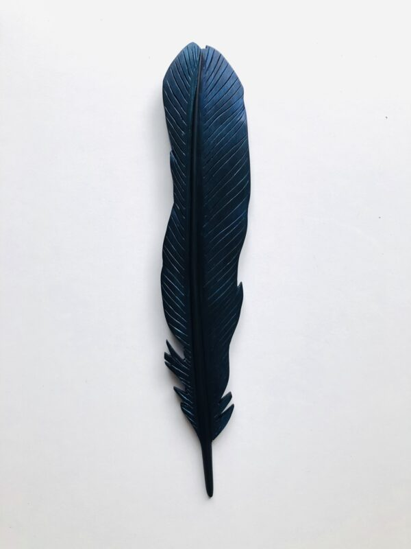 carved tui feather art